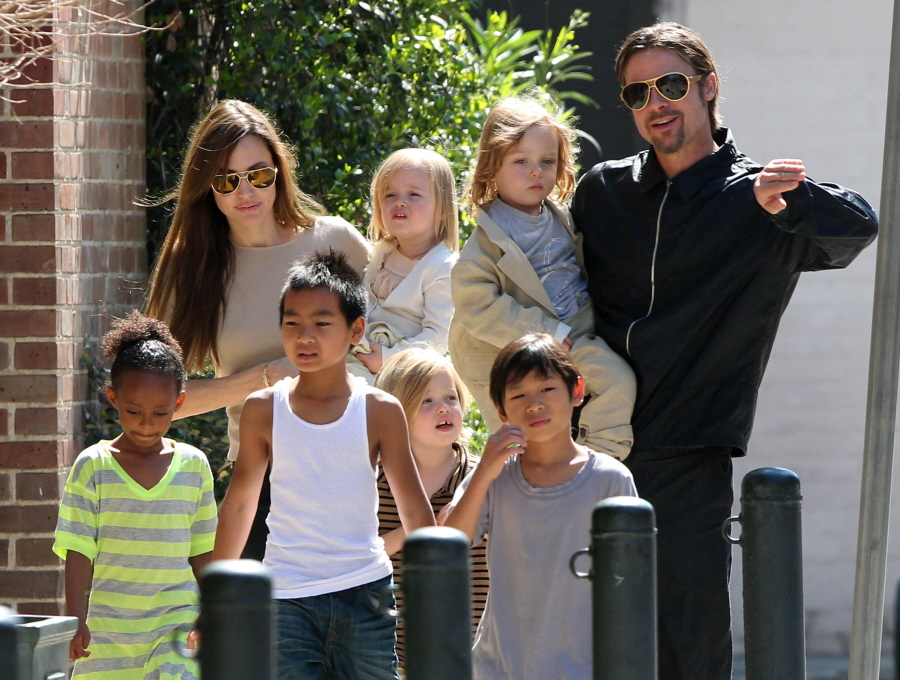 """#7006830 The Jolie-Pitt family headed out in New Orleans, Louisiana to do some grocery shopping at a local market on March 20, 2011. Angelina has brought all six children to visit their dad Brad Pitt while he works on his latest project """"Cogan's Trade"""". Maddox, Pax, Zahara and Shiloh walked while the twins Knox and Vivienne hitched a ride from mom and dad who were all smiles while out and about on a lovely sunny day. Brad and Angelina waved to fans as they strolled the street to and from the market. Fame Pictures, Inc - Santa Monica, CA, USA - +1 (310) 395-0500"""