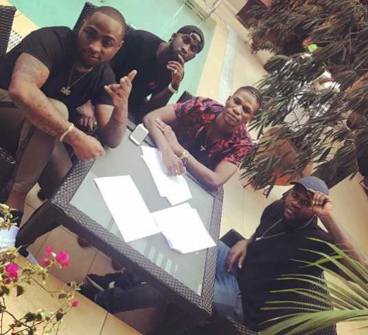 Davido-with-new-signing-Yonda-and-others-Instagram