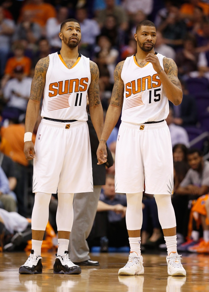 PHOENIX, AZ - FEBRUARY 10:  Markieff Morris #11 and Marcus Morris #15 of the Phoenix Suns during the NBA game against the Houston Rockets at US Airways Center on February 10, 2015 in Phoenix, Arizona. NOTE TO USER: User expressly acknowledges and agrees that, by downloading and or using this photograph, User is consenting to the terms and conditions of the Getty Images License Agreement.  (Photo by Christian Petersen/Getty Images)